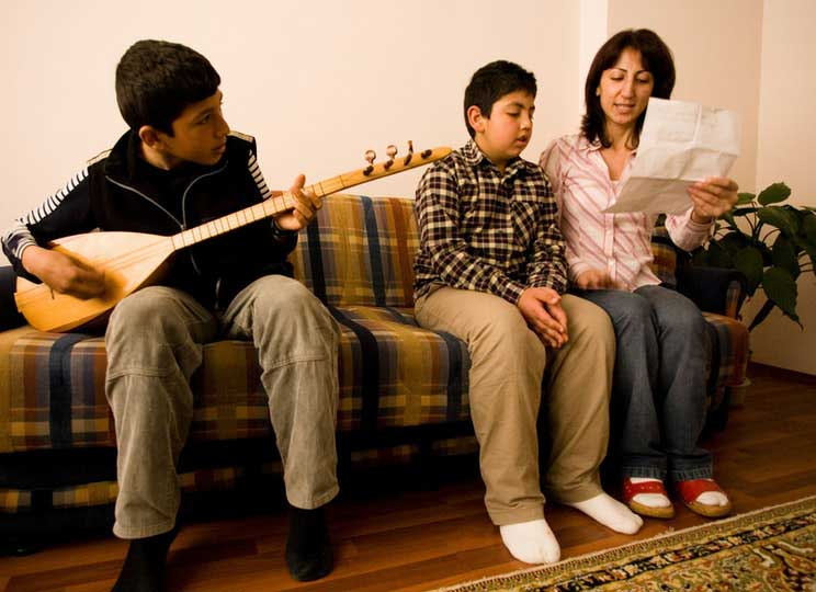 Junior youth playing an instrument and reading