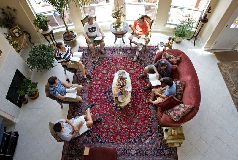 Group of adults studying the Ruhi books at a study circle